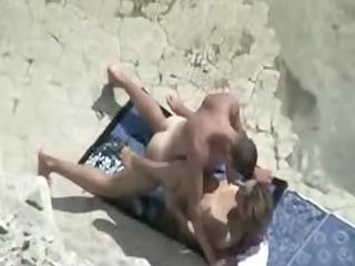 grownup seaside bang movie scene of pair caught