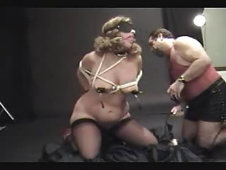 bound woman spanked