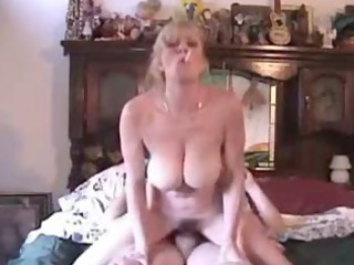 extremely impressive milf with giant real boobs