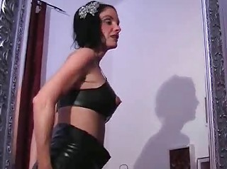 slutty latex woman playing