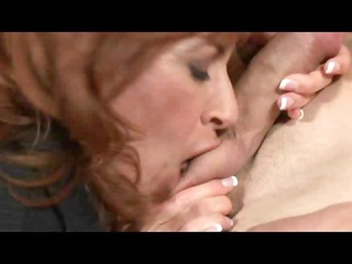 naughty woman mikela sinuates on a desk during