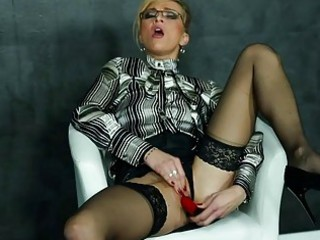 dildoing woman into blouse and highheels