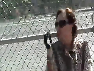 beautiful cougar aunt smoking inside leather