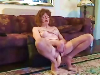 cougar cd gets a large plastic cock into her butt