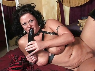 horny brunette lady into busty latex galoshes