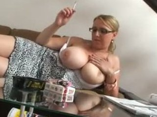 pale lady with very big tits smokes