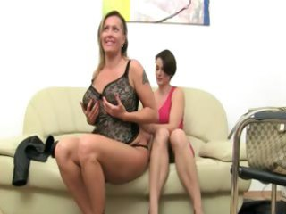 older  woman banging on leather armchair