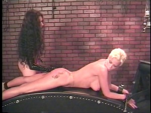 dominatrix uses unmerciful toys on busty albino