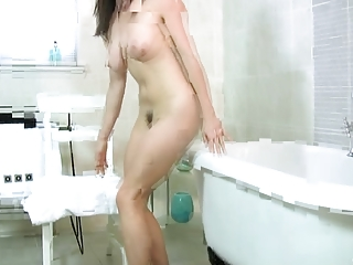 naughty woman fist herself inside the tub
