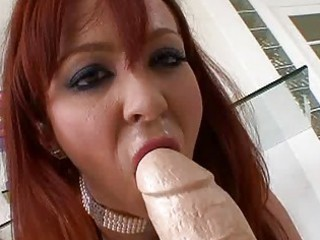 busty redhead lady masturbating with giant sex