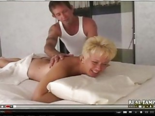 amateur mother pierced on massage desk