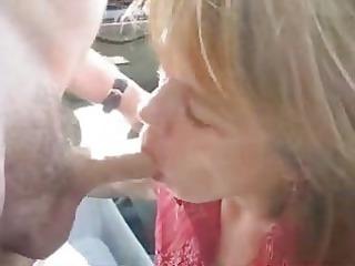 lady getting a facial sperm in public