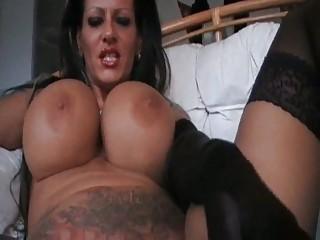 naughty super boobed woman smoking inside brown