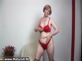 naughty elderly woman getting nude inside a hot